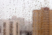 Raindrops on glass window — Stock Photo