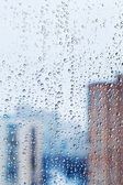 Raindrops on home glass window — Stock Photo