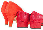 Two pairs heelpieces of red women's shoes — Stock Photo