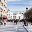 People on street in Paris in spring - Stock Photo
