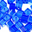 Blue glass cubic bugles close up — Stock Photo