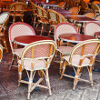 Cane-chairs in paris cafe - Stock Photo