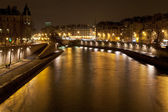 Seine river in Paris at night — Stok fotoğraf