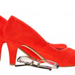Red high heels woman shoes and eyeglasses — Стоковая фотография
