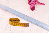 Pink and yellow measure tapes and metal ruler — Stock Photo