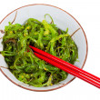 Постер, плакат: Eating of chuka salad seaweed salad
