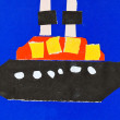 Child's applique - ship in blue sea — Stockfoto