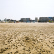 Resort buildings on sand beach in Le Touquet — Stock Photo #26632375