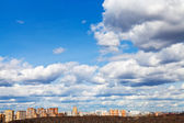 Skyline with spring evening clouds — Stock Photo