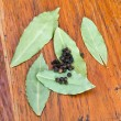 Stock Photo: Bay leaves and black peppercorn