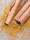 Top view of sticks and powdered Cinnamon — Stock Photo