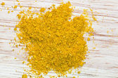Top view of curry powder pinch — Stock Photo
