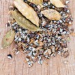 Dried seeds and freshly milled cardamon — Stock Photo #27322567