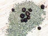 Ground black pepper spice and peppercorns — Stock Photo