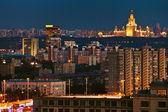 Illuminated city in summer night — Stock Photo