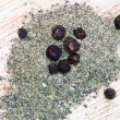 Milled black pepper and peppercorns — Stock Photo