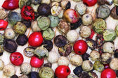Different peppercorns close up — Stock Photo
