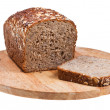 Stock Photo: Grain bread loaf and sliced piece