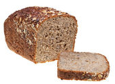 Grain bread loaf and sliced hunch — Stock Photo