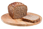 Grain bread loaf and sliced piece — Stock Photo