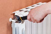 Adjusting heating radiator — Stock Photo