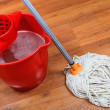 Stock Photo: Cleaning of floors by mop