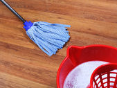 Mopping of wooden floors — Stock Photo