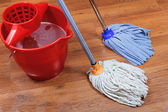 Cleaning of wet floors by two mops — Stock Photo