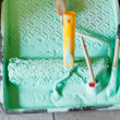 Plastic paint tray and paintbrushes — Stock Photo