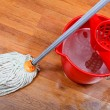 Stock Photo: Cleaning of wet floors by mop