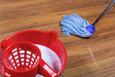 Mopping of parquet floors — Stock Photo
