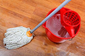 Cleaning of wet floors by mop — Stock Photo