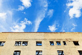 Blue sky above furbished house — Stock Photo