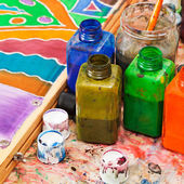 Paintbrush and bottles with dyes — 图库照片