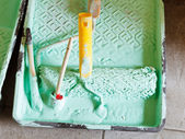 Tray with paintbrushes and paint roller — Stock Photo