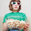 Girl watching TV movies in 3D stereo glasses — Stok fotoğraf