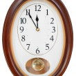 At five minutes to twelve on wall clock — Stock Photo