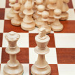 Chess pieces against the king and queen — Stock Photo