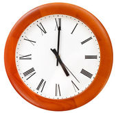 Five o clock on round dial wall clock — Stock Photo