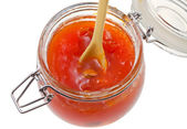 Apricot jam in glass jar close up — Stock Photo