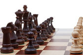 Black chess pieces and white pawns — Stock Photo