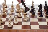 Black king hits white king in chess game — Stock Photo