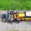 Workers and tractor remove asphalt — Stock Photo