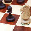 Stock Photo: Wooden knight on chessboard