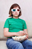 Girl watching TV movies in 3D stereo glasses — Stock Photo