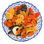 Top view of dried fruits on turkish plate — Stock Photo