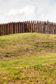 Wall from wooden stakes on rampart — Stock Photo