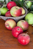 Fresh summer apples on wooden table — Stock Photo