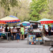 Stock Photo: Tourists on street market Vernissage in Yerevan