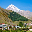 Stock Photo: Town Kazbegi and Mount Kazbek in Georgia